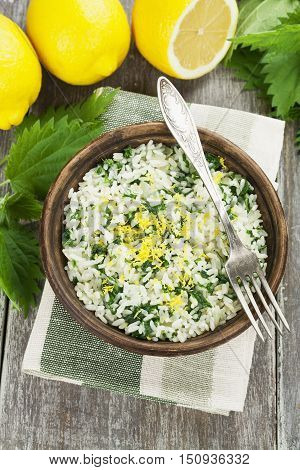 Risotto with nettles and lemon in the ceramic plate