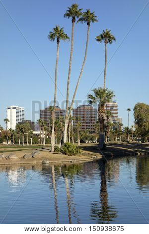 Phoenix downtown as seen across the lake in Encanto Park Arizona; Copyspace