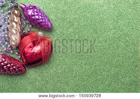 Christmas Toy Bump And Christmas Heart Shaped Red Ball On Green