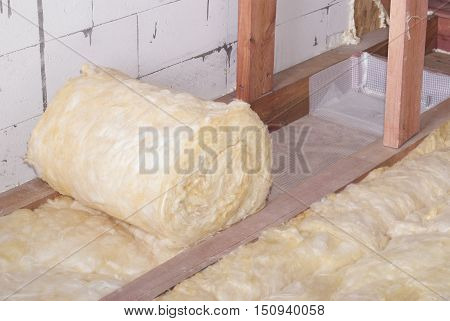 roll of mineral wool insulation in the attic floor