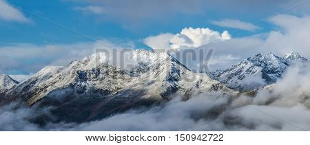 First snow at tops of mountains. Dawn. Greater Caucasus Mountain Range. Caucasus mountains. Karachay-Cherkessia. Russia.