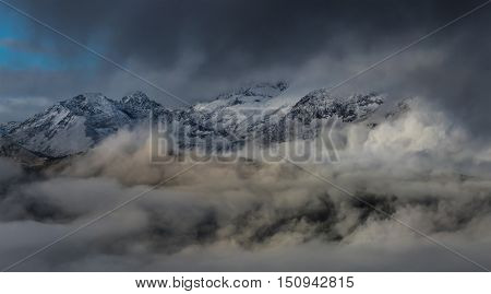 Birth of clouds high in mountains on a foggy morning. Greater Caucasus Mountain Range. Caucasus mountains. Karachay-Cherkessia. Russia.