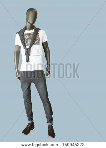 Full length male mannequin dressed in t-shirt and gray jeans isolated. No brand names or copyright objects.