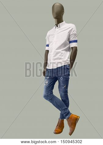 Full length male mannequin dressed in shirt and blue jeans isolated. No brand names or copyright objects.