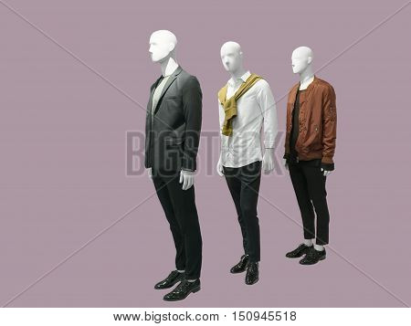 Three man mannequins dressed with fashionable modern clothes isolated. No brand names or copyright objects.