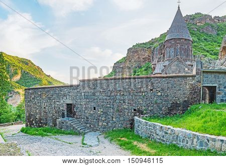 The Geghard Monastery surrounded by massive fortress wall and located on the of Azat River Gorge Kotayk Province Armenia.