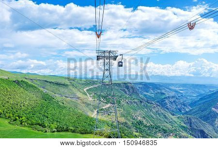 The scenic landscape of Vorotan Canyon with the cableway tower of the Wings of Tatev in the middle Syunik Province Armenia.