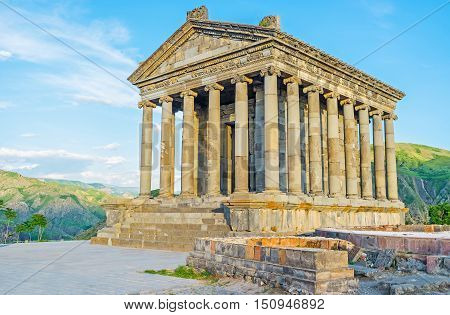 The tall colonnade of the grey stone Garni Temple located at the edge of the Garni gorge Kotayk Province Armenia.