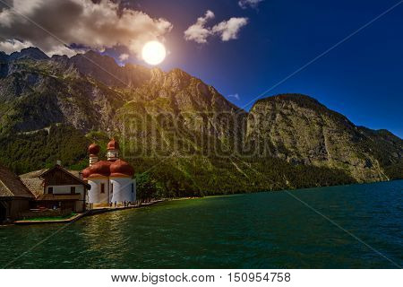 Sunset over St.Bartolomei Church on Bonigsee Lake in Bavaria, Germany