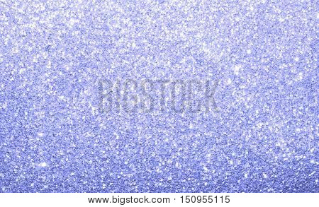 Light blue sparkle glitter abstract background.  Twinkle and shine on decorative backdrop.