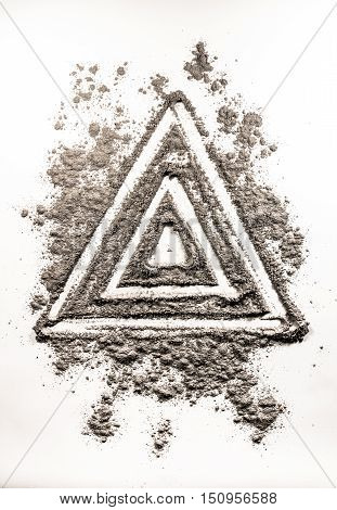 Triangle shape symbol drawing in grey ash as a order in chaos
