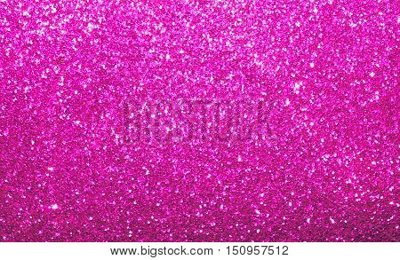 Sparkle and shimmer, vibrant bright pink background.  Abstract  colorful shine and twinkle backdrop.