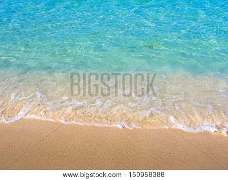 Close up of tropical and clear water of the Caribbean beach of Canto de la Playa, Saona Island, Dominican Republic. Sea and shore background. Concept of summer and Caribbean vacations.