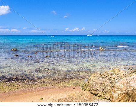 Reef to the shore of Bayahibe beach, near La Romana, a popular resort in the Dominican Republic. Tropical clear caribbean waters with reef for great snorkeling.