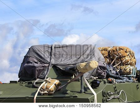 Airborne combat vehicles with arranged cargo parachutes before loading on the plane for airdrop