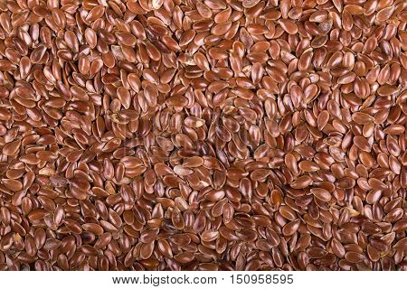 A background of dried flaxseeds, also known as linseed.
