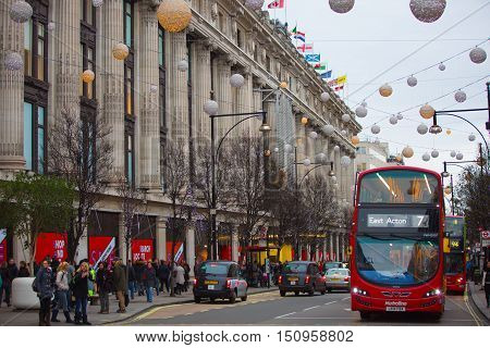 LONDON, UK - DECEMBER 30, 2015: Christmas lights decoration at Oxford street and lots of people walking during the Christmas sale,