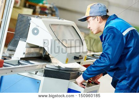 industrial worker with buzz saw circular blade for cutting metal