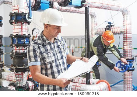 construction engineer worker at industrial boiler room