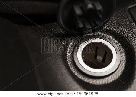 Car Cigarette Lighter Socket Closeup Photo. Twelve Volts Electric Vehicle Outlet.