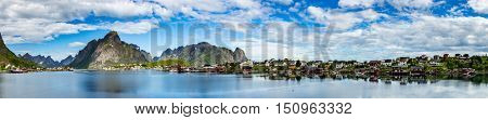 Panorama Lofoten islands in the county of Nordland, Norway. Is known for a distinctive scenery with dramatic mountains and peaks, open sea and sheltered bays, beaches and untouched lands.