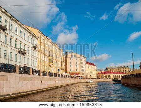 ST PETERSBURG RUSSIA-OCTOBER 3 2016. Historic buldings and embankment of Moika river in sunny day in St Petersburg Russia. Archtiecture city view of St Petersburg Russia