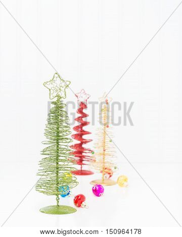 Three colorful stylized christmas trees with ample copy space.