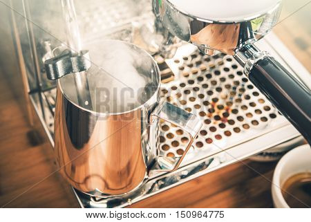 Steaming Milk For Cappuccino Coffee. Steaming Milk in Metal Steaming Pitcher