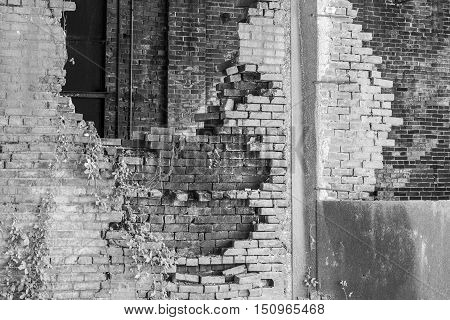 Crumbling Brick Wall of the former Power Plant at the Central Indiana Hospital for the Insane built in 1886 and abandoned in the 1970s VI