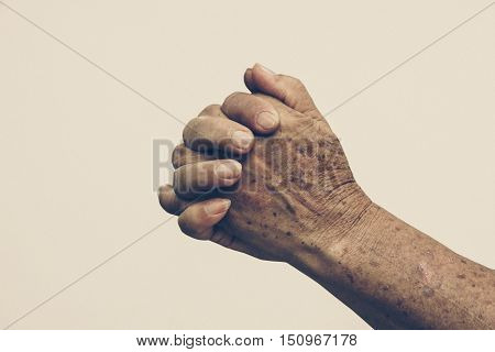 Fingers crossed female hands with each other. Prayer. Hands of a female elderly