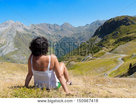 a woman tourist admiring views of the mountains.