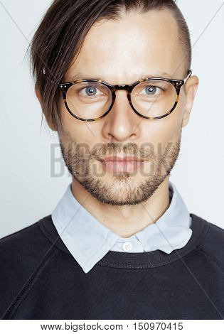 handsome middle age man with modern hairstyle and tattoo, beard, close up on white background, lifestyle real people concept