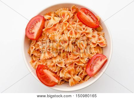 Pasta and tomato sauce in white circle shape bowl