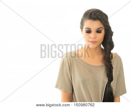 Beautiful young woman with braided hair studio shot