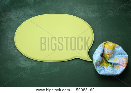 inflated globe with speech bubble
