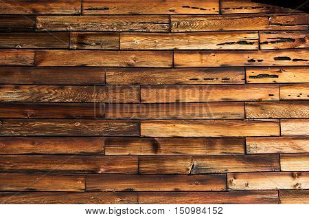 Close up of rows of old weathered short wood boards on old house