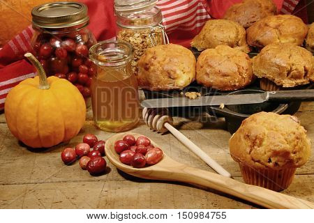 Freshly made pumpkin and berry muffins on table