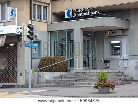 Wallisellen, Switzerland - 9 October, 2016: entrance to the Zurich Cantonal Bank office on Bahnhofstrasse street. Cantonal banks are commercial banks, which are provided with a guarantee for the assets held there by the canton in which they are based