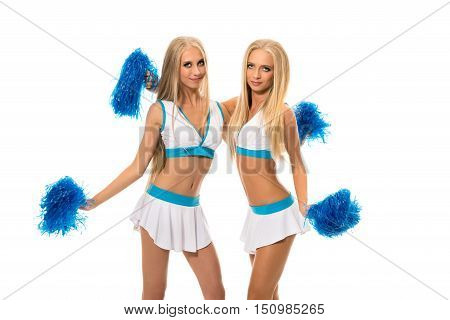 Support team. Studio image of pretty girls with pom poms
