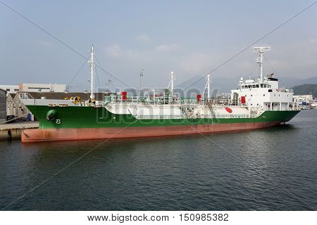 View of LNG cargo ship docked in the port