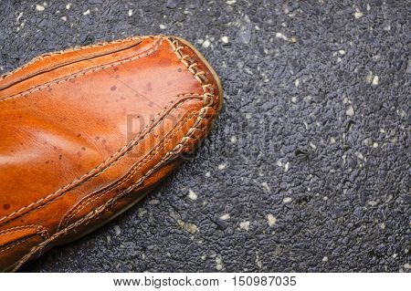a men's sneakers part of mocassin for autumn on cement ground