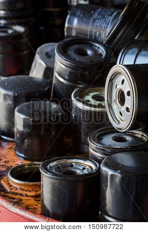 Picture of old fuel filters of diesel engines. Old car or automobile oil filters represented in automobile service center.