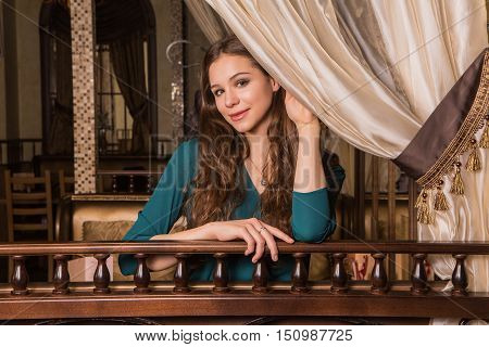 Portrait Of Young Female In Restaurant