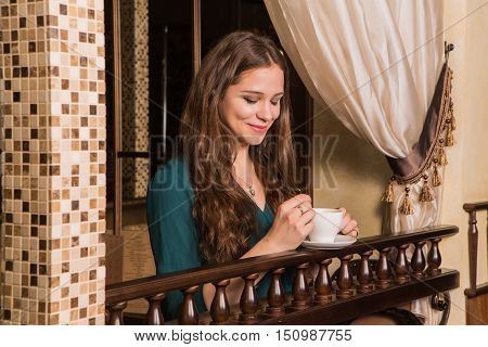 Portrait Of Young Female Student With Coffee Cup