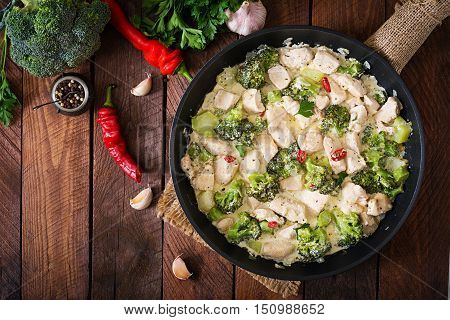 Delicate Saute Chicken With Broccoli And Chili Peppers In A Creamy Garlic Sauce. Top View
