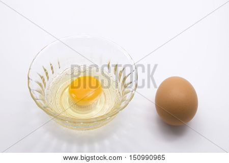 Raw Egg with Eggshell on White Background