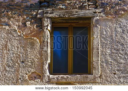 Dilapidated Window in a Medieval French City