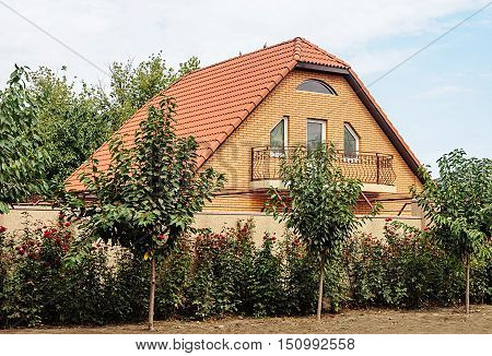 Odessa, Ukraine - August 30, 2016: Small brick private two-storied residential house. Sunny summer day.