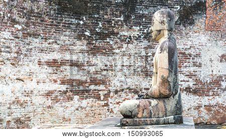 Ancient City of Polonnaruwa, stone Buddha statue at Vatadage (Circular Relic House) in Polonnaruwa Quadrangle, UNESCO World Heritage Site, Sri Lanka, Asia.