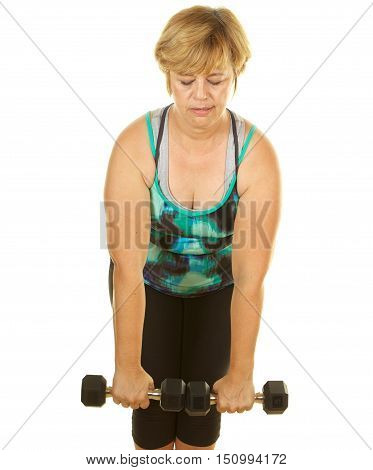 Middle Age Woman Exercising with Weights on a White Background.  She is doing a dead lift
